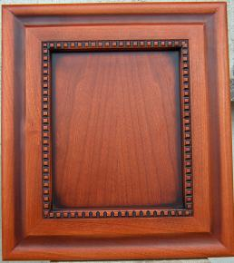 Molding decorated door panel for kitchen furniture